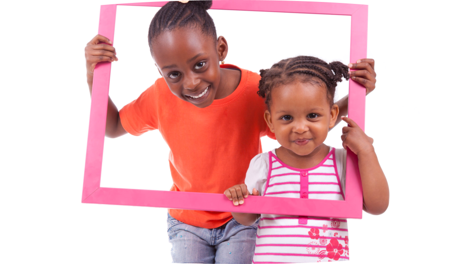 two child in a pink portrait