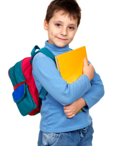 boy with bag holding a book